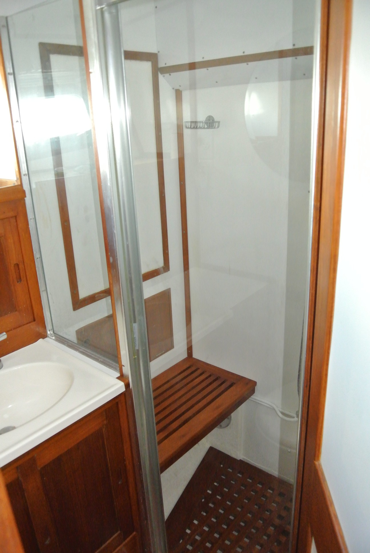 Forward head with a separate shower stall.