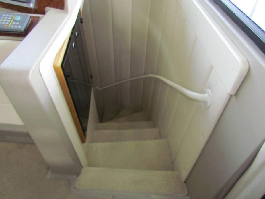 Stairs from the Pilothouse to the lower deck where the living quarters are located.