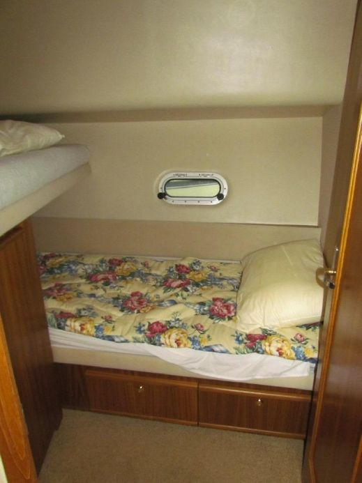 Guest Stateroom. The lower berth will sleep an adult. The upper berth will sleep a child, or better yet, as a place to store luggage and supplies.