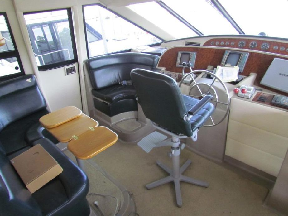 The Pilothouse. She has both port and starboard doors. The flybridge access is just via 4 steps.